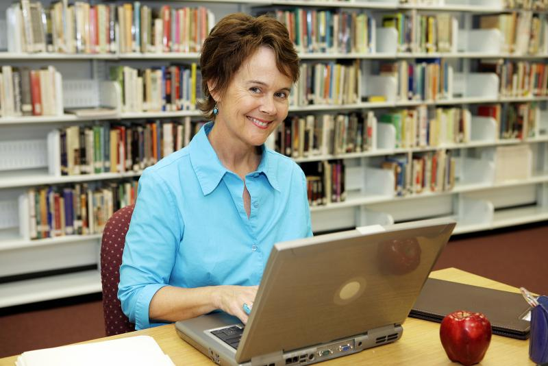 pretty-librarian-working-on--11982029